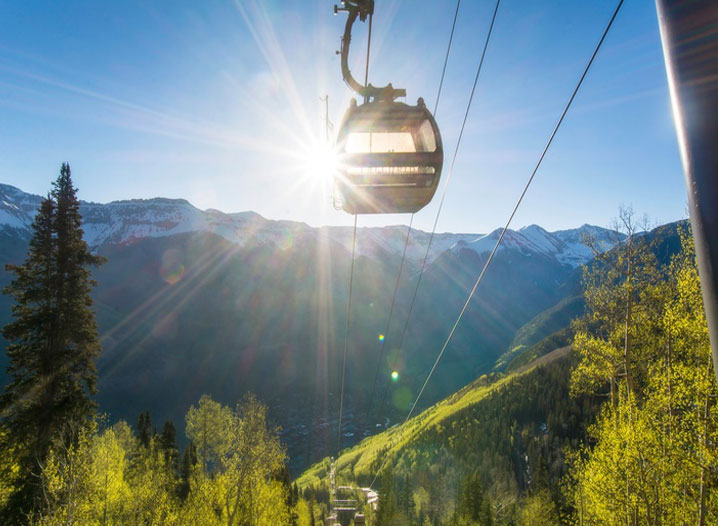 Gondola Sun and Snow Cap Mountains